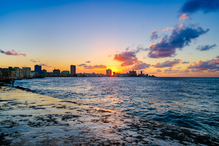 Sunset in Havana with a view of the ocean and the city skyline