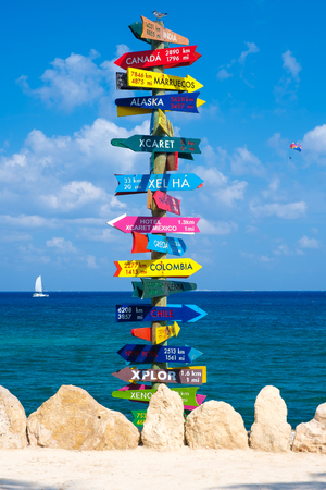 Sign with directions to all the parks owned by the XCaret group on the Mayan Riviera and to different countries Фото со стока