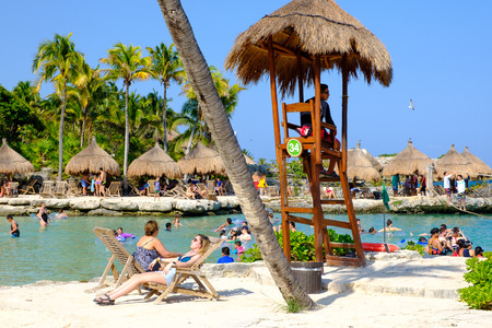 Families at the beach at XCaret Park on the Mayan Riviera on a beautiful sunny day in Mexico Editorial