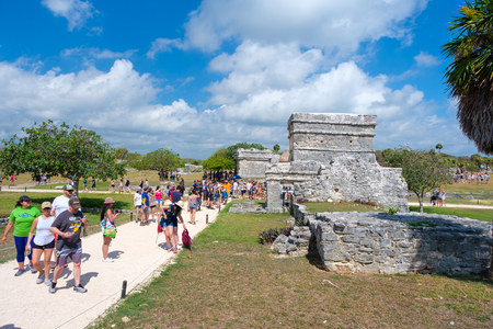 TULUM,MEXICO - APRIL 18,2019 : Visitors at the ancient mayan ruins of Tulum in Mexico