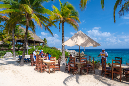 XCARET,MEXICO - APRIL 16,2019 : Restaurant at the beach on the XCaret park on a beautiful sunny day Редакционное