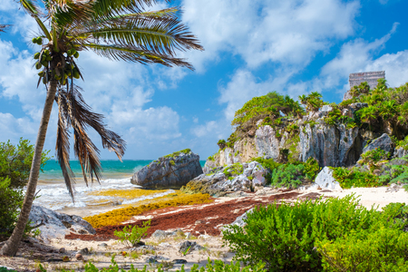 Beautiful beach and mayan ruins at the archeological site of Tulum in Mexico Фото со стока