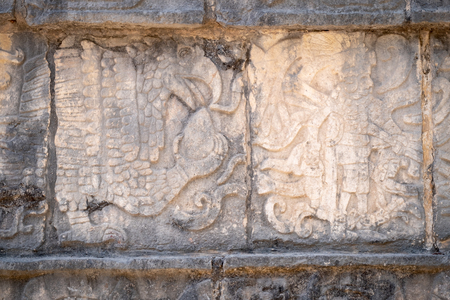 Ancient mayan stone relief representing a king and an eagle