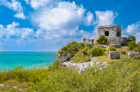 Mayan ruins on top of a cliff at the ancient city of Tulum in Mexico Stock Photo