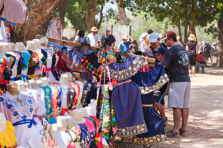 Handicraft market selling traditional mexican dresses at Chichen Itza