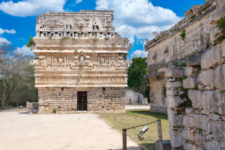 Temple with elaborate carvings at the ancient mayan city of Chichen Itza in Mexico