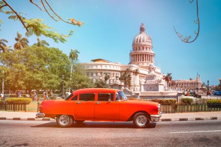 Classic american car next to the Capitol building in Old Havana Stock Photo