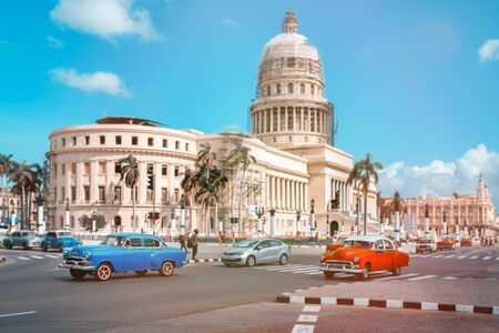 Classic cars in Havana next to the Capitol building
