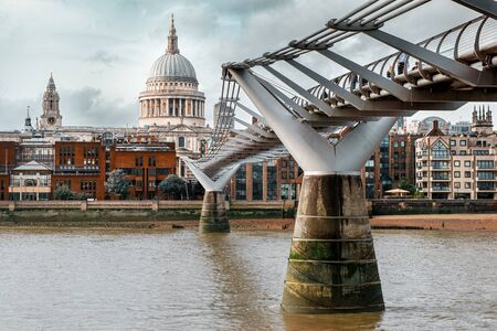 The Millenium Bridge and Saint Paul Cathedral in London on a typical cloudy day