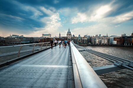 The Millenium Bridge and Saint Paul Cathedral on a typical rainy day in London