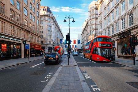 Traditional red buses at The Strand, a historic avenue in central London