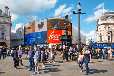 Tourist and locals at Piccadilly Circus on a sunny summer day in London