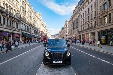 Typical London taxi at the famous Regent Street in central London