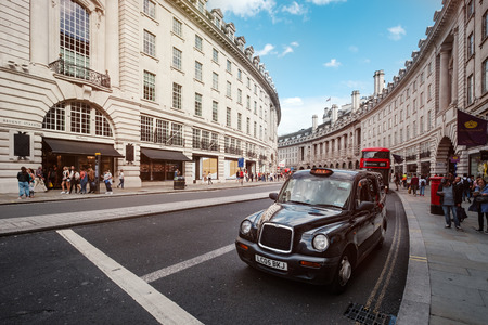 Typical London taxi and double decker bus at the famous Regent Street in central London