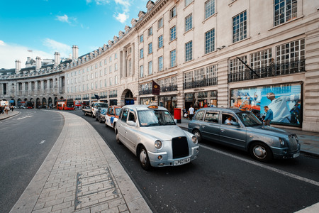 Typical London taxis at the famous Regent Street in central London Redakční