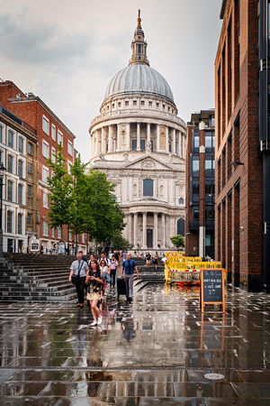 Saint Paul Cathedral in London on a rainy day with reflections on the floor