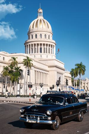 Street scene with old classic cars and the famous Capitol of Havana Stock Photo