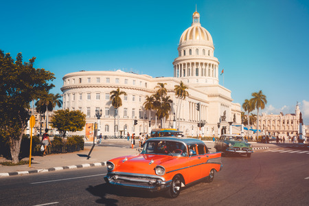 Colorful vintage cars next to the iconic Capitol building in Havana Sajtókép