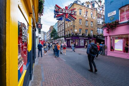 LONDON,AUGUST 19,2019 : Carnaby street, a famous shopping street in Soho
