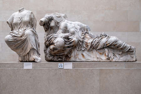 LONDON,UK - JULY 31,2019 : Statues of greek goddesses, part of the Elgin Marbles exhibited at the British Museum and originally located at the temple of the Parthenon in Athens Editorial