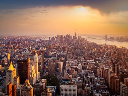 Aerial view of New York City illuminated by the rising sun