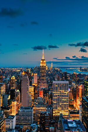 Aerial view of New York City at sunset with several worldwide known landmarks