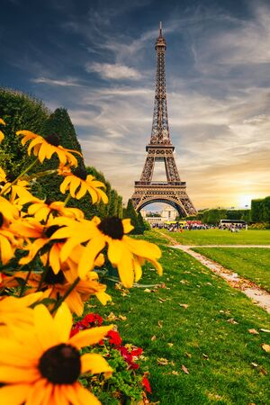 The Eiffel Tower in Paris at sunset - with colorful flowers