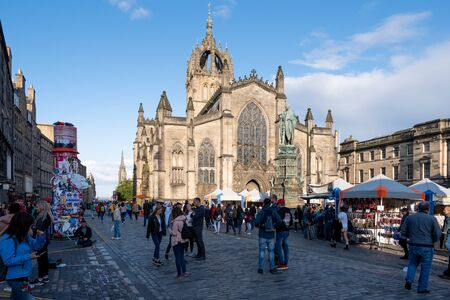 View of The Royal Mile and St Giles Cathedral with tourists and locals participating in The Fringe