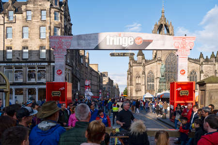 Tourists and locals participating in the Fringe festival in Edinburgh - the largest art festival in the world Editorial