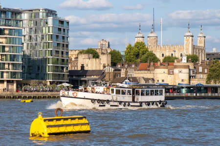Cruise boat on the river Thames with a view of the Tower of London