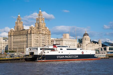 Cruiser ship docked at the Port of Liverpool with a view of the famous Three Graces buildings Фото со стока
