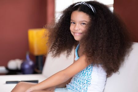 Portrait of a cute multiracial small girl with beautiful curly hair