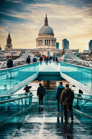 The Millennium Bridge and St Paul Cathedral in London at sunset