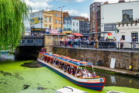 Colorful boat on the Regent's Canal in Camden Town with a view of Camden Market