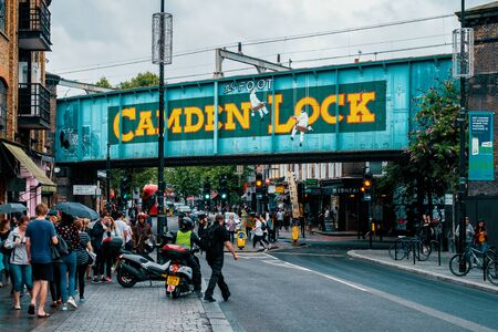 Famous painted Camden Lock sign on a railway bridge in Camden Town
