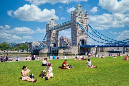 People enjoying summer near Tower Bridge in London
