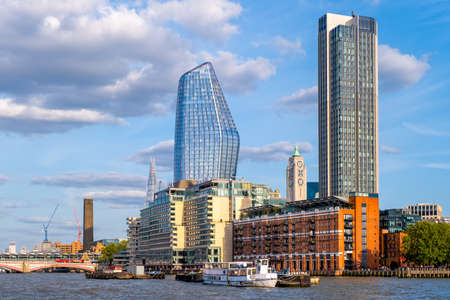 Waterfront apartment buildings and a view of the river Thames in London