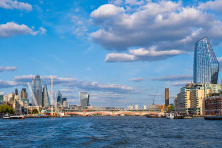 The river Thames and several landmarks on a beautiful summer day in London