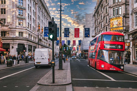 Street scene with double decker bus at The Strand in London