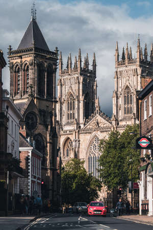Street scene in York with a view of the York Cathedral and several historic buildings Editöryel