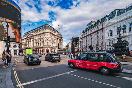 Traffic at Piccadilly Circus in London with a view of several landmarks Editorial