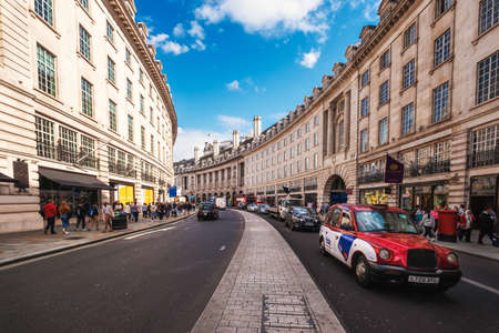 One of the iconic London taxis at Regent Street, a major shopping street famous for its architecture and its flagship stores