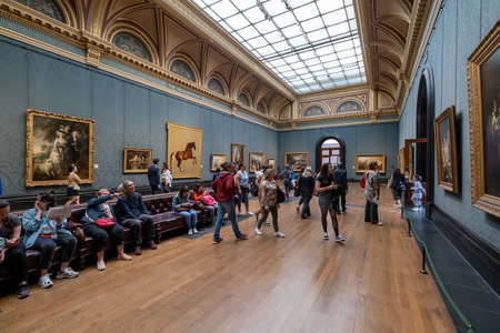 Visitors at the National Gallery in London. Founded in 1824 , it houses a collection of over 2300 paintings