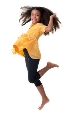 Multiracial small girl jumping and laughing - Isolated on a white background Standard-Bild