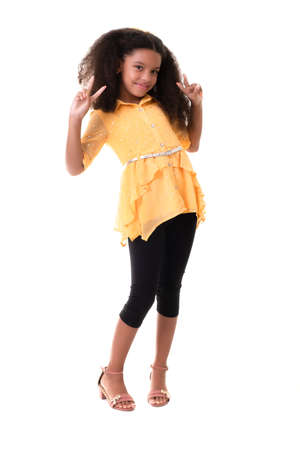 Portrait of a trendy multiracial small girl isolated on a white background - Doing the victory sign Standard-Bild