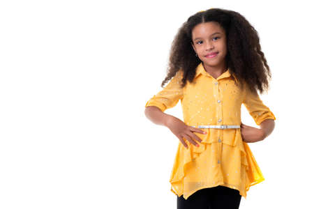 Portrait of a trendy multiracial small girl isolated on a white background Standard-Bild
