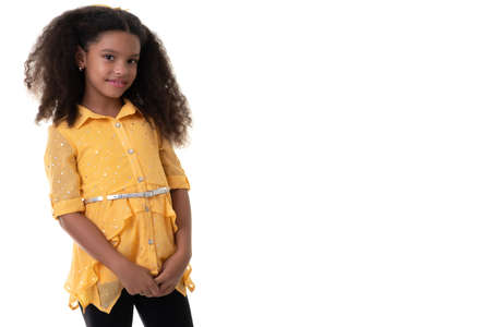 Portrait of a trendy multiracial small girl with beautiful curly hair- Isolated on white