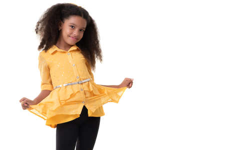 Cute multiracial small girl with a beautiful curly hair - - Isolated on a white background
