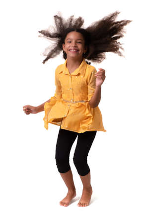 Happy multiracial small girl jumping and laughing - Isolated on white Standard-Bild