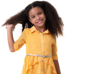 Cute multiracial small girl showing her beautiful curly hair - Isolated on a white background